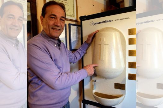 Photo of Luciano Marabese and his holy water dispenser